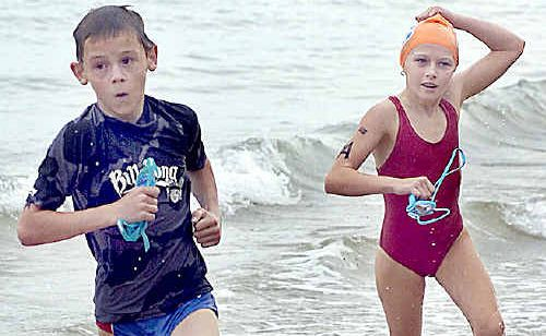 Lachlan Hopgood and Kayla Munson hit the beach in the under 10 race on Sunday.