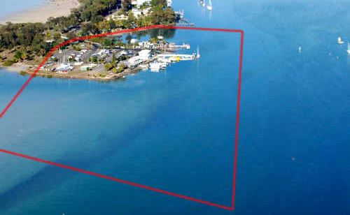 The entrance to Snapper Creek at Tin Can Bay will be changed forever once a new Marina is built on Norman Point. The outline in red shows the approximate size of the development and the impact it will have on the creek.