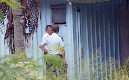 Regional crime co-ordinator Detective Inspector Jon Wacker investigates where a murder suspect was found in Yeppoon yesterday.