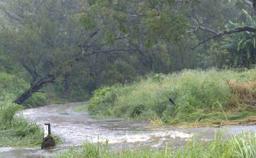 Floodwaters at Struck Oil caused problems for Ergon crews on Tuesday who were trying to restore power.
