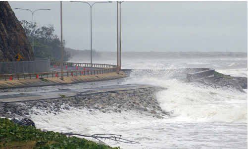 Strong winds and high tides combined caused the waves at Yeppoon's Main Beach to wash over Farnborough Road.
