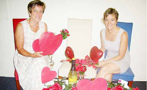 Joan Brazier (left) and Debbie Hannam from the Maryborough Zonta club get ready for the Valentine's Day celebration.