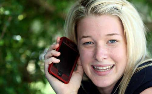 Jae Hinkley makes the most of her mobile phone before the trip to Fiji.