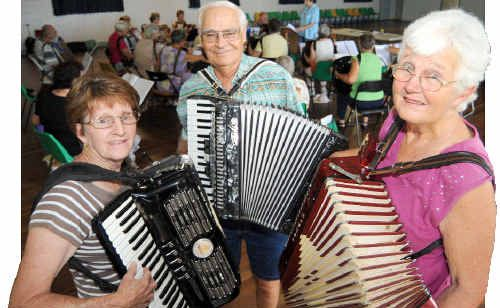 Lorraine Haywood, Ron Perkins and Amy Guppy are part of Australia's largest accordion band and practice every Thursday. Photo: Max Fleet acc0402a