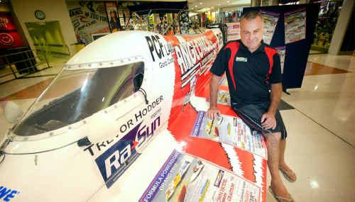 President of Australia Formula Powerboat Grand Prix Craig Truslove with a Formula 2 boat on display in Grafton Shoppingworld.