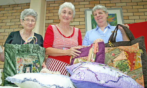 U3A president Jennifer Somerville (centre) with Lynn Smith and Lesley Olivieri from the hand embroidery group.