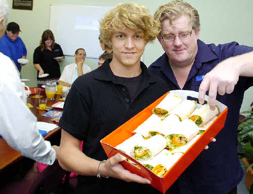 The New Camera House owner Jon Paterson sneaks a salad wrap from Jimi Moyle, 17, of Lismore, during a meeting of the Lismore Business Promotion Panel. Jimi and Jeremy Earl, 19, of Lismore, and Jamie-Lee Cresswell, 17, of Dunoon, are involved in the YWCA initiative Community in the Kitchen.