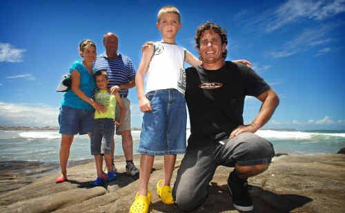 Angus Lambert was rescued by Justin Henwood at Turners Beach. Angus was swept out to sea in a rip on Thursday in three-metre swell conditions, while his family Skye, Jarrod and Glenn watched on.