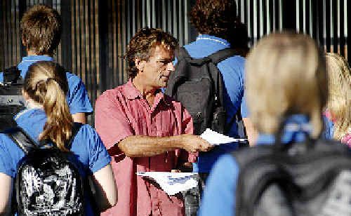 Steve Drummond hands out fliers pleading with students to come forward with information relating to the death of his son, Jai Morcom.