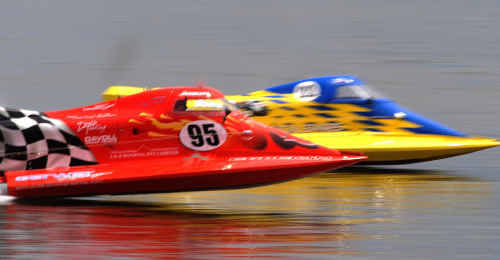 Corey Davoll (front) and Geoff Bollins go at it down the river during second round of the Grafton Formula Powerboat Grand Prix on the Clarence River.