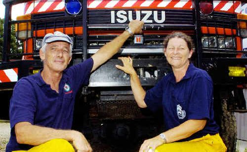 Mullumbimby RFS members Neville McLean and Leah Ross used their 4WD truck to get through swollen causeways to a pregnant woman at Upper Wilsons Creek yesterday.