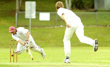 Alstonville's Andrew Larrecey takes a tumble after a delivery from Ballina's Ben Collins in their LJ Hooker League match at Hill Park Oval, Wollongbar, on Saturday.