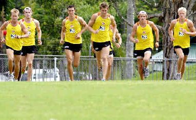 The Gold Coast AFL team in the middle of their training run at Oakes Oval, Lismore, yesterday.
