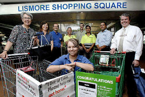 Supporting the abandoned shopping trolleys campaign are (clockwise, from front) Sharna Gordon of Coles, Lismore mayor Jenny Dowell, Vanessa Tallon of the Lismore City Council, Jeff Staude of Kmart, trolley contractor Toby Hunter, Jason Pitt of Woolworths, trolley contractor Amikal Singh, Garry Luyten of Big W and centre manager Geoff Gooch.