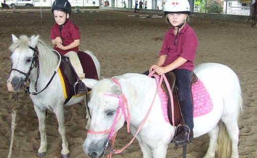 Zacharee Ridgley and Erin Kachel had a blast on their white ponies.