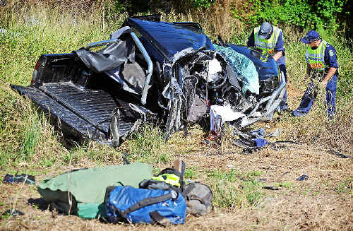 The wreckage of a ute involved in a collision on the Pacific Highway about 2km north of Ulmarra.
