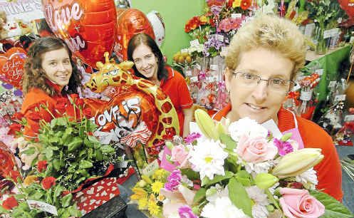 Flower Box Florists owner Karen Moller, with Jenny Jensen and Tash Moller, has had a busy lead-up to Valentine's Day. Photo: Rob Barich val1202b