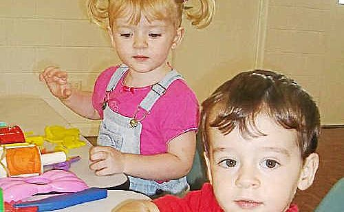 Twins Jodie and Lukas Dodd enjoy the playdough activity at the Woodgate Playgroup last week. Photo: SUE PALMER