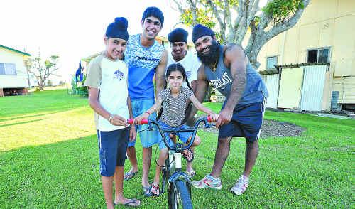 Rajan Gill, Jaskaran and Sabi Singh and their cousin Manvir Singh teach Sukhman Gill to ride a bike.