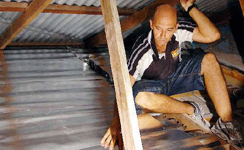 Scott Harding from Coastal Solarwise looks over his product as the company moved yesterday to reassure customers there was nothing to fear in the wake of the latest insulation-related death.