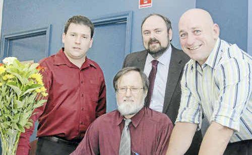 Signing an agreement for Gladstone's new superclinic are Matt Burnett (left), Dr Evan Jones (back centre), Dr John Bird (front centre) and MP Chris Trevor.
