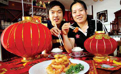 At Bauhinia Chinese Restaurant in Brisbane Road, Mooloolaba, Anna and Jimmy Ye celebrate.