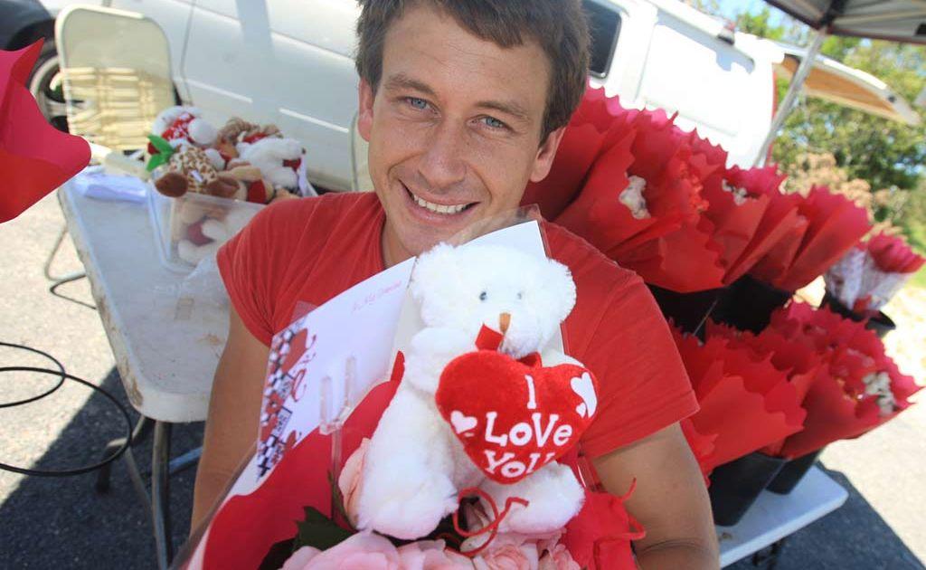 Tweed River Roses seller Kane Jeffreys prepares for Valentine's Day.