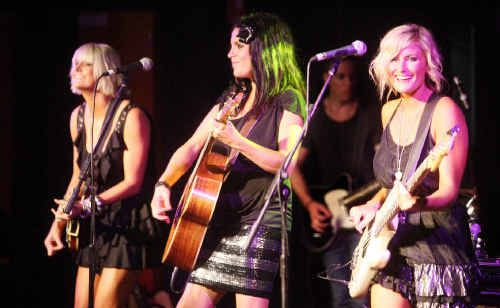 Brooke, Mollie and Sam McClymont kick off their gig at the Yamba Bowling Club.