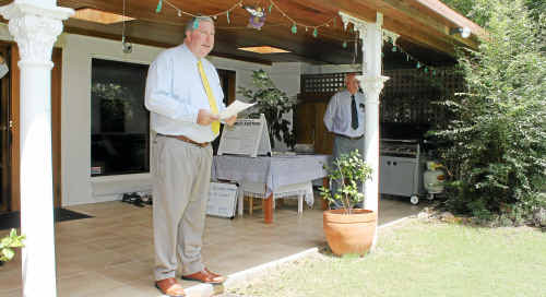 Neil Carney, of Warwick Real Estate, reads the terms and conditions before yesterday's auction in Hawker Road, Warwick.