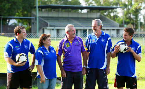 Rhinos rugby league president Tony Stackhouse, middle, joins soccer club officials to mark their affiliation.