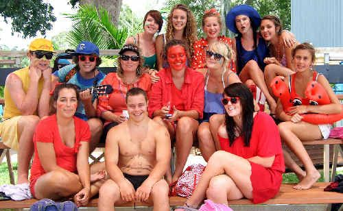 Teacher Kate Keogh (centre, second row) was in a sea of colour – red – at Evans River K-12's swimming carnival.