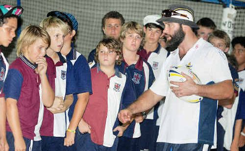 Cowboys development officer Dean Payne talks to Mackay State High students.