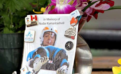 Flowers surround Nodar Kumaritashvili's photo.