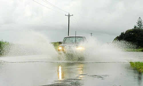Fairymead Road copped the brunt of the wet weather yesterday. Photo: SCOTTIE SIMMONDS road1602f