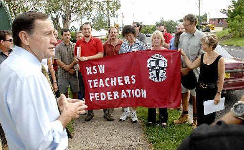 NSW Teachers' Federation deputy presidentGary Zadkovich (left) addresses Kyogle High School teachers during their strike outside the school yesterday.