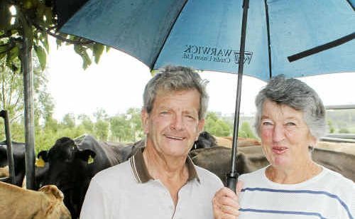 GRAHAM and Nancy Hoey surrounded by the wet stuff at Freestone yesterday.