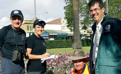 Fewer nominations: (From left) Tidy Towns judges John and Lou Carothers, council gardener Andrew Smith and Cr Neil Meiklejohn during the judges' visit last year.