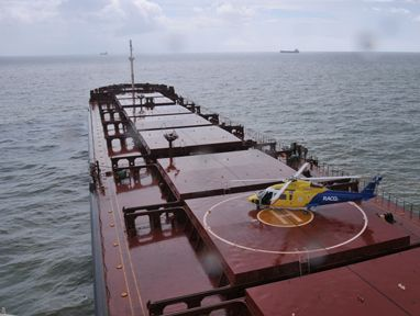 The RACQ Capricorn Rescue Helicopter lands on the cargo ship River Embley this morning.