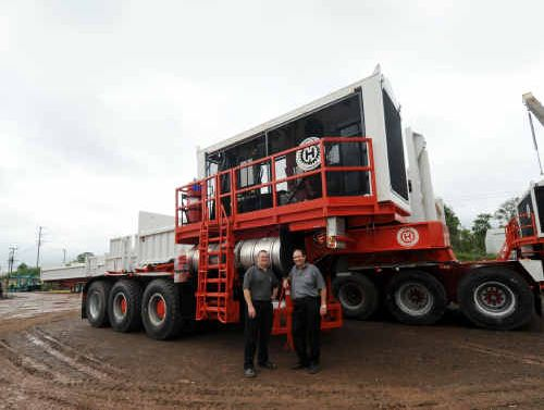 Kerren Smith of J Smith and Sons, with the firm's engineering manager Kevin McDonnell and their new Hydrapede, at the firm's Gympie factory.