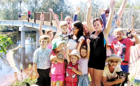 Residents of South Golden Beach celebrate the start of work on the Helen Street footbridge.