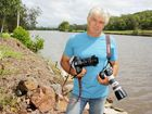 Sunshine Coast cinematographer Mike Middleton stands on the banks of the Maroochy River, a waterway he's been photographer for years for his new book Our Maroochy.