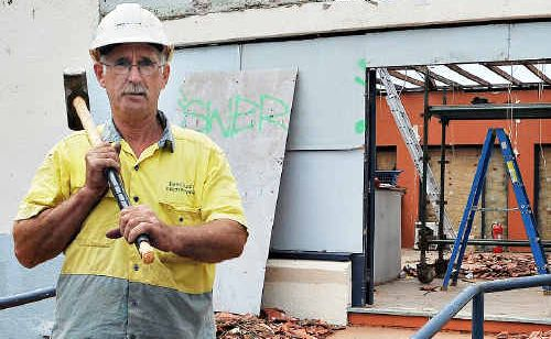 Demolition supervisor Dennis Lyons hard at work at the historic building yesterday.