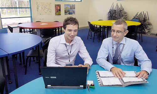 French teacher Sam Oglethorpe (left) with principal Tony Wood.