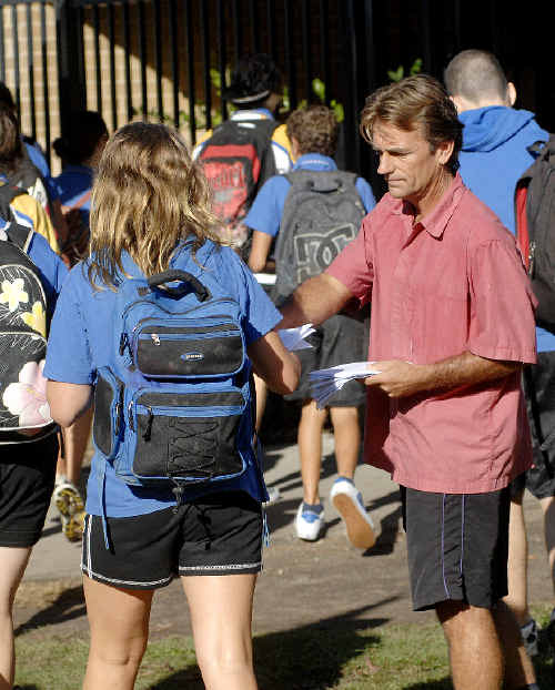 Jai Morcom's dad Steve Drummond hands out pamphlets titled Truth 4 Jai to students as they arrive at Mullumbimby High School two weeks ago.