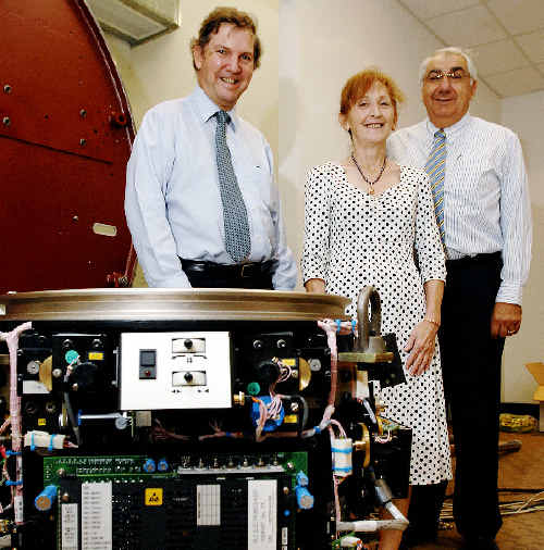 NCAHS CEO Chris Crawford (left), Federal MP for Page Janelle Saffin, and NSW MP for Lismore Thomas George with the newly-installed medical linear accelerator at Lismore Hospital.