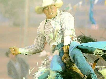 Cowboy Fred Osman hangs on during a recent rodeo competition.