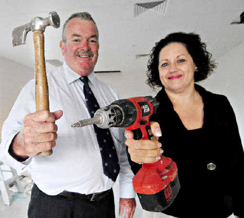 QantasLink commercial general manager Elsa D'Alessio and Coffs Harbour City Council Mayor Keith Rhoades gave construction teams a hand at the Coffs Harbour Regional Airport yesterday.