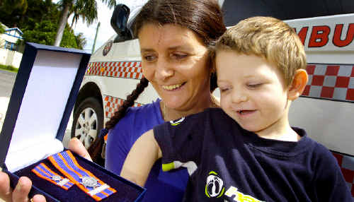 Bravery award winner Sandra Lawler receives her medal with son Ben Leadbeatter (3). Ms Lawler trekked through swollen river crossings and up cliffs with her two sons to get baby Samuel, not pictured, to hospital after he developed breathing problems.
