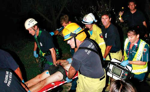 Emergency services attend to victims of a fall from the Point Cartwright cliffs last night.