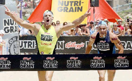 Shannon Eckstein (left) celebrates after edging out Tugun rival Hugh Dougherty in the final of the Kelloggs Nutri-Grain Ironman series in Sydney yesterday.